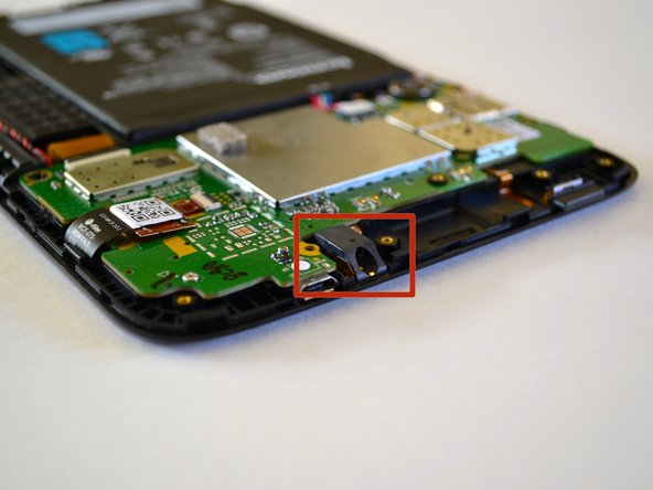 Locate the audio assembly near the top-right of the device.