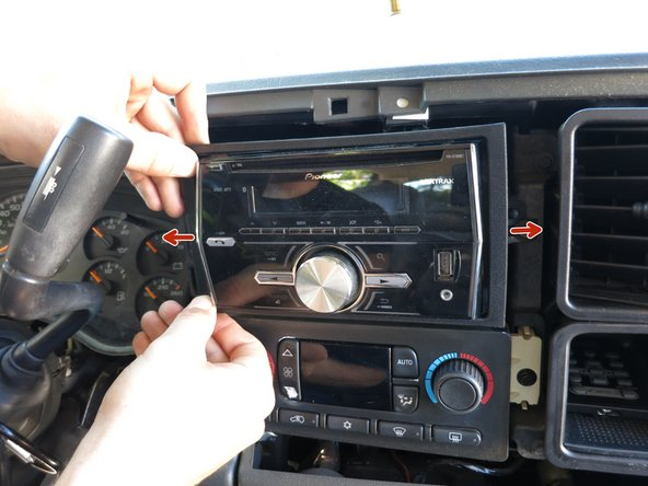 Remove the face plate from the head unit.