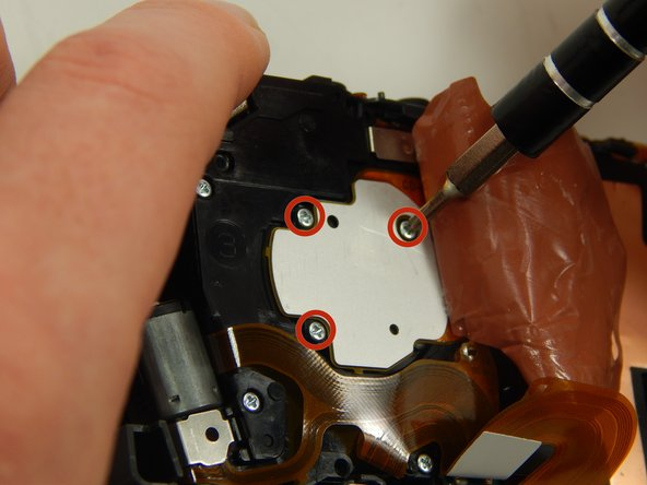 Unscrew the three marked screws (2mm) using a Phillips #000 Screwdriver.