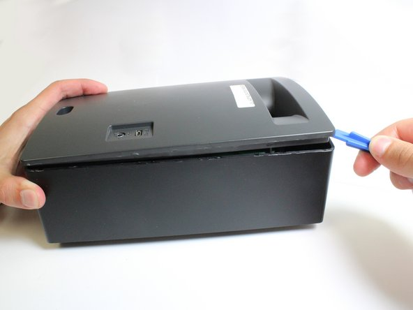 Image 1/2: If the panel does not come free easily, a heat gun may be needed to weaken the adhesive.