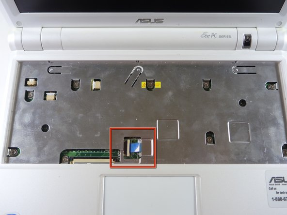Flip the laptop back over and identify the touchpad ribbon.
