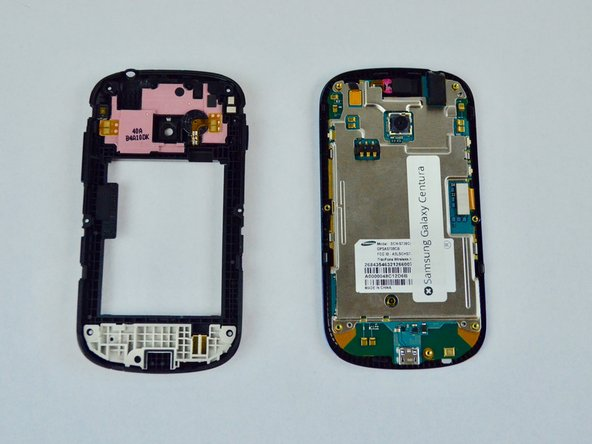 Gently pull apart the plastic, and set it aside. The phone should now appear as shown in the second picture.