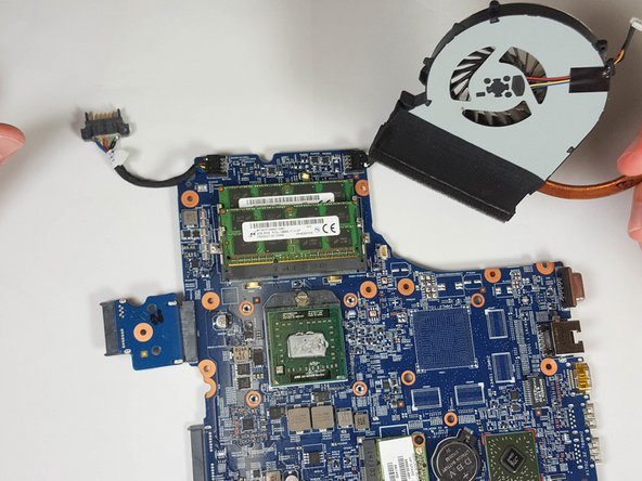 Lift the fan from the motherboard to fully remove it.