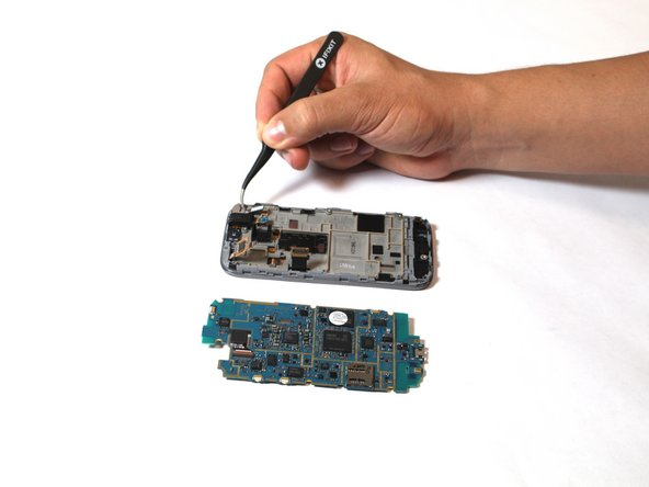 Image 2/2: At this point the motherboard should be completely detached from the rest of the phone.
