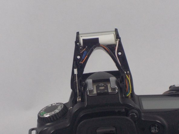 Image 3/3: Then, lift off the top casing of the flash.