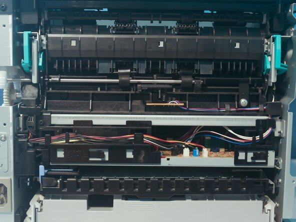 The back cover can be removed by removing 4 screws on the back of the printer.
