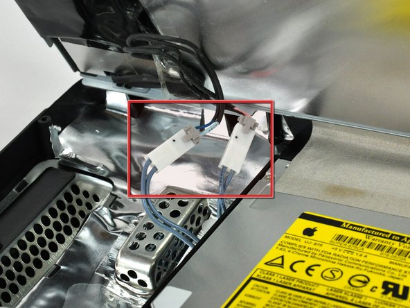 Image 1/2: During reinstallation, place the four inverter cable connectors in voids between components attached to the rear panel so the display panel will sit flush.