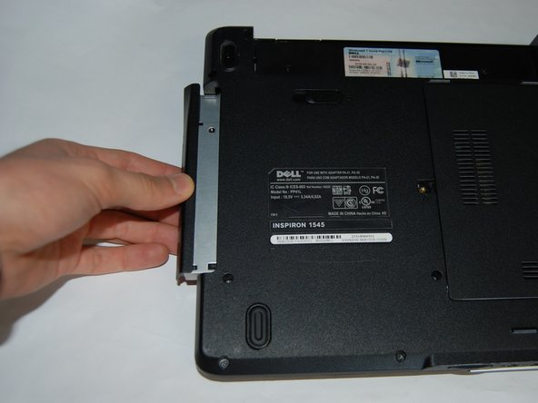 Push the Optical Disk Drive out using a spudger tool as shown and pulling from the front cover of the Optical Disk Drive.