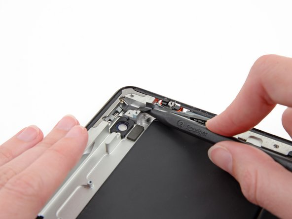 Continue sliding the tip of the spudger toward the top of the iPad, releasing the adhesive.
