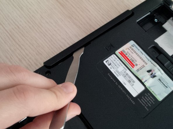 first remove the screw at the back of the laptop (bottom) see first picture