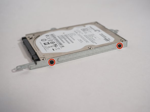Image 2/3: Remove the drive from the chassis. Care that the drive does not fall out once all the screwshave been removed.