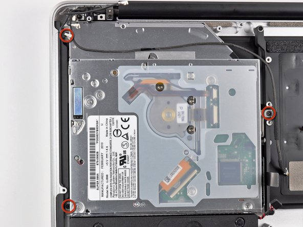 Image 1/2: Remove the three 3.5 mm ( 3.3 mm ) T6 Torx screws securing the optical drive to the upper case.