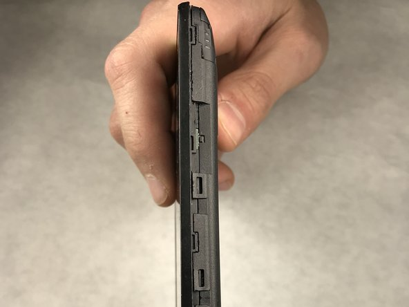 Use a metal spudger to release all of the clips around the phone. These clips are used to hold the front and back panel on the phone together.