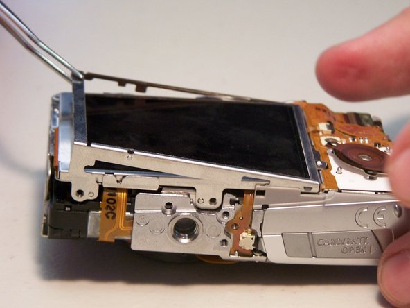 Image 2/2: Remove the three quarter bracket around the LCD screen.