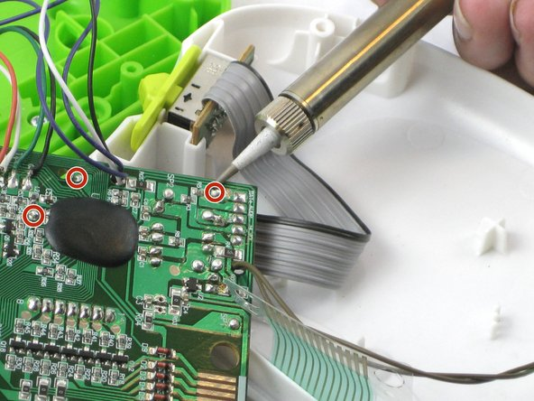 Remove the battery wires from the motherboard with the soldering iron.