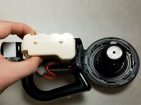 Remove the battery unit by pulling  it out of the  main body.