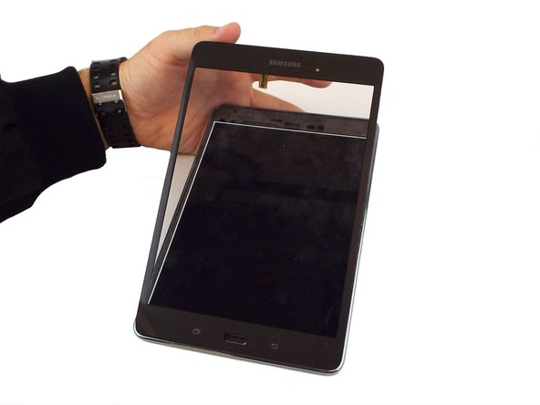 Once the touchscreen is loose enough, slowly pull it off the front cover to fully remove it from the rest of the device.