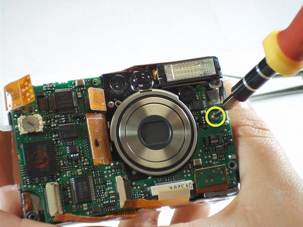 Remove one 3.9mm screw from the right side of the  motherboard and under the flash.