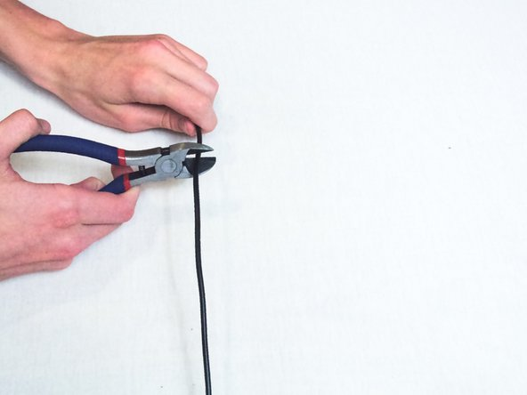 Remove the broken portion of the USB cable with the wire cutters.
