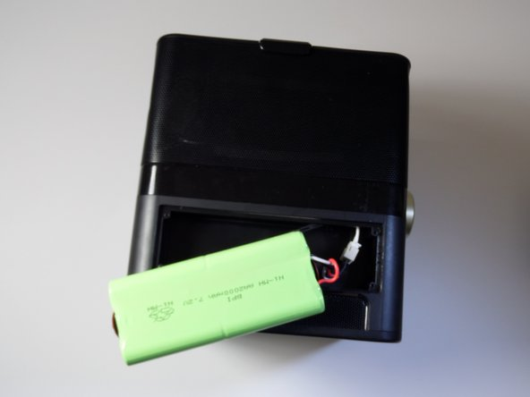 Image 2/2: The battery does not lift STRAIGHT UP.  Lifting in this manner could damage the battery, wires, and/or the device.