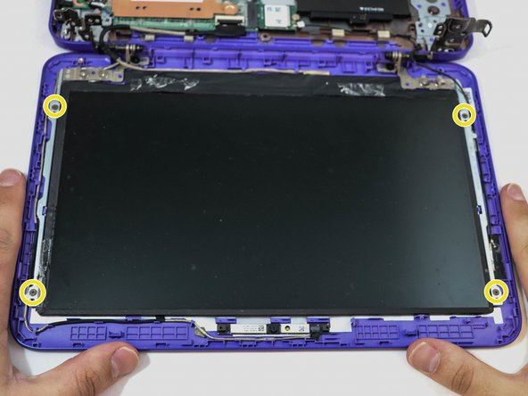 Continuing with the Phillips #0 screwdriver, remove four 2mm screws that hold the screen in place.