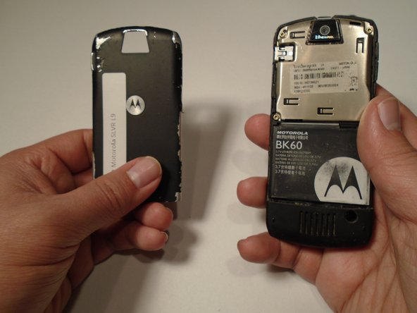 Image 3/3: Pull the battery cover down and away from the latch; then lift it up to remove the battery cover.