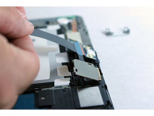 Pull out the charge port and the SD card slot.