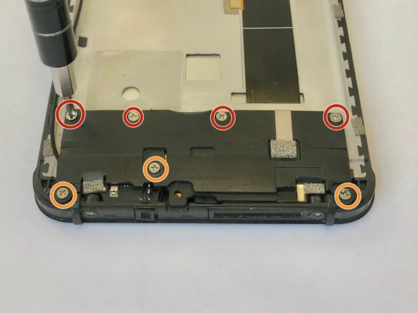 Use a Phillips #000 screwdriver to remove each of the four 1.5mm screws.
