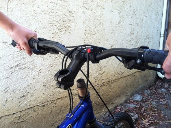 When loose enough, slide the handlebars off the frame.