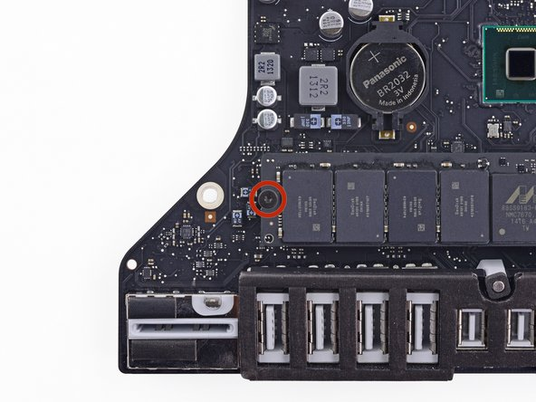 Remove the single Torx screw securing the SSD to the logic board.