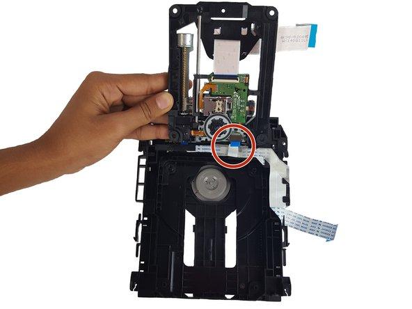 Flip the disk reader up like a flip phone.