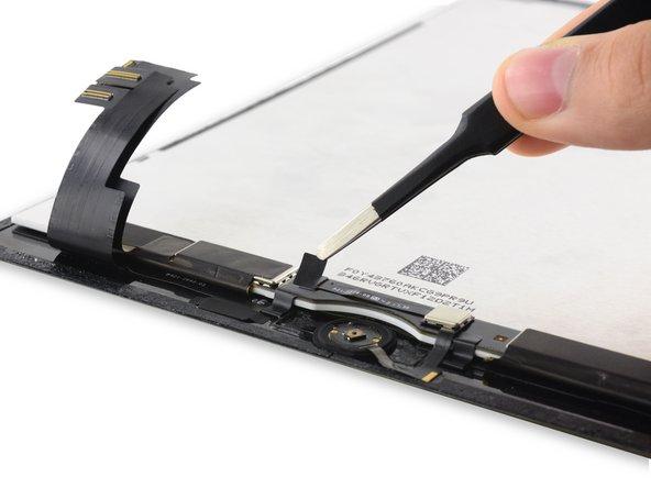 剥离覆盖在Home键ZIF连接器上的胶带。