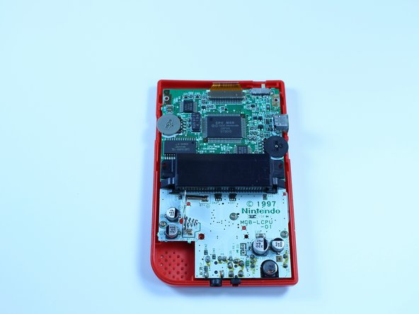 Image 3/3: Set the back cover aside. You will need it to reassemble the device