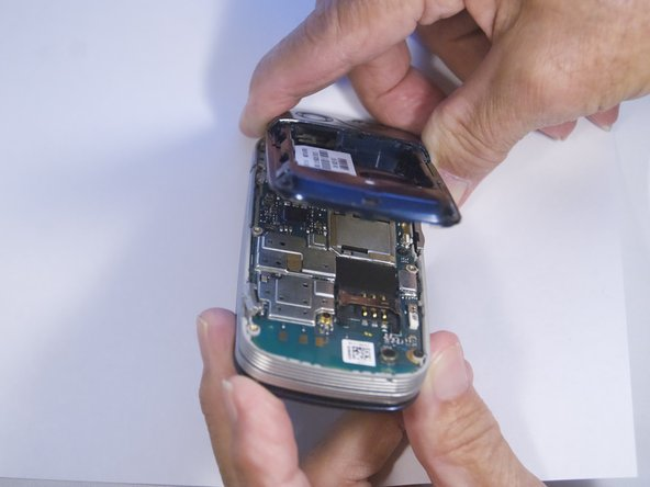 Use spudger to separate phone casing and inside as shown.