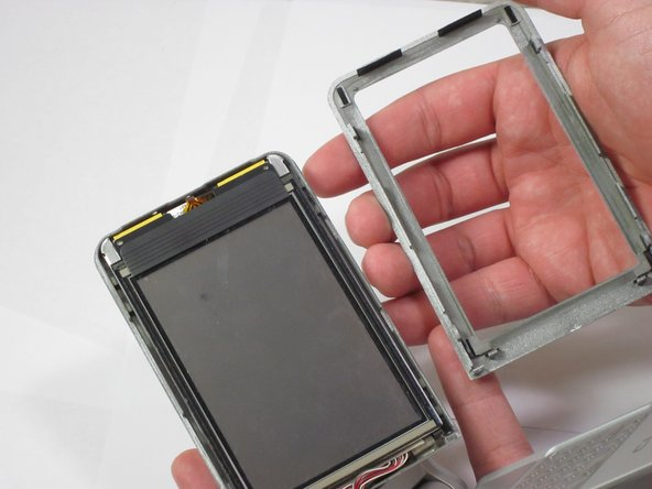 Remove front panel from the screen. You should be able to do this by gently pulling the pieces apart with your hands