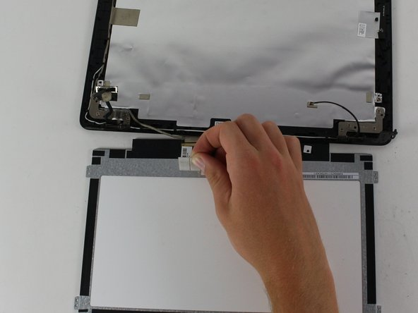 Peel the tape that holds the cable connector in place and slide the connector out.