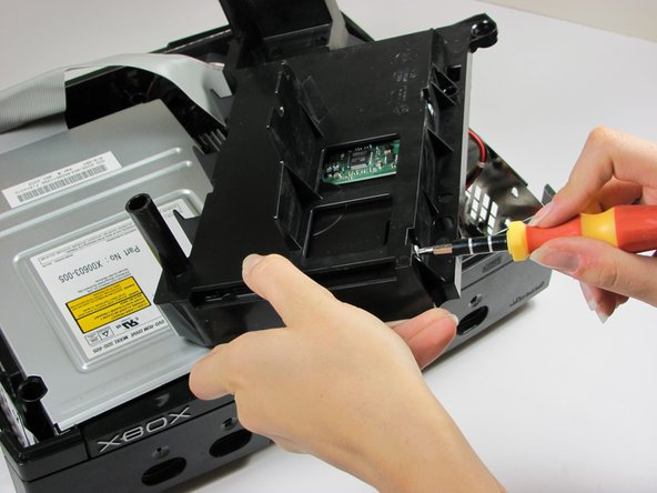 Carefully remove the hard drive from the plastic carrier.  Gentle rocking will see the hard drive come out quite easily.