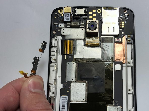 Pull the button assembly up and out of the phone.