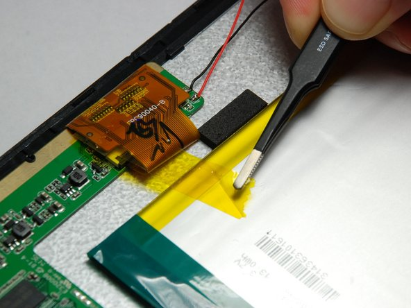 Use wide tip tweezers to gently remove the three pieces of tape attached to battery.
