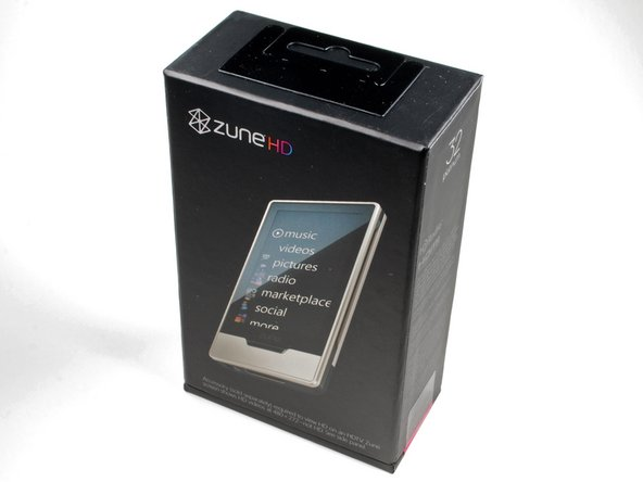 "Image 1/2: Sparing no expense, we got the 32 GB ""Platinum"" model. However, it seems you need to spend an additional $90 if you want to get HD out of the Zune HD..."