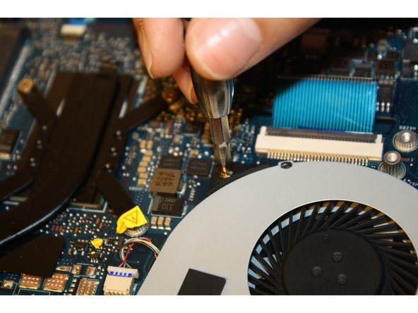 Remove the screws attached to the cooling fan with a PH-1 screwdriver.