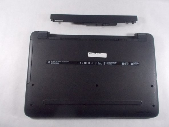 Take the new battery and line it up with the slot.