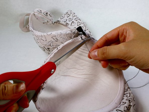 Trim the thread with scissors. Leave a few millimeters of thread leftover to ensure that the knot does not come loose.