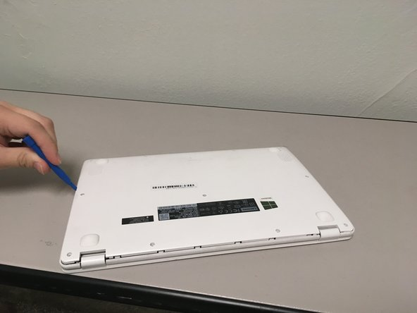 Separate the back lid from the laptop using a plastic opening tool.