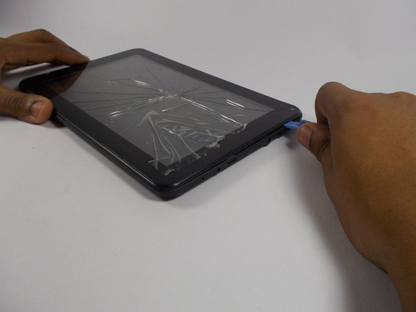 Insert a plastic opening tool between the screen and the rear case and carefully pry the tablet open.
