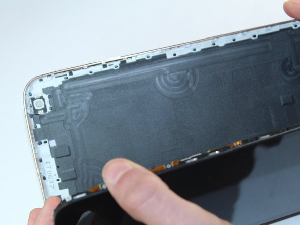 Once every part of the screen is separated from the back cover, you should be able to fully remove it with your hands.