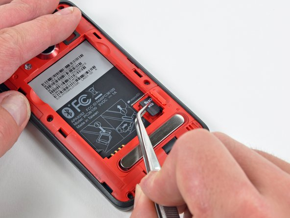 Use a pair of tweezers to carefully pull the MicroSD card out of its slot in the inner rear frame.