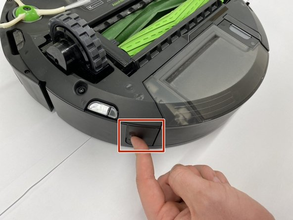 Flip the iRobot Roomba i7 so that the underside is facing upwards and the back is facing you.