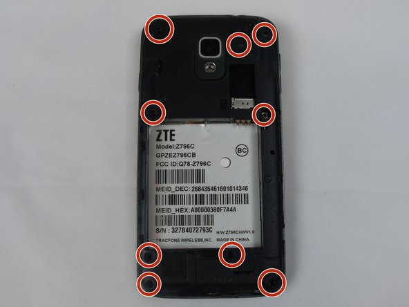 Remove the back of the phone by removing the 9 PH000 shown