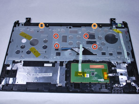 Image 1/1: Remove the two M2x3 screws with a PH0 Phillips screwdriver.